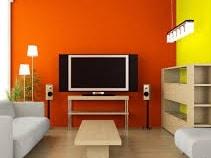 Parete di salone imbiancata color arancio e giallo