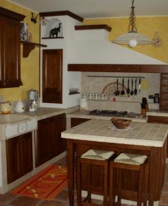 Idee Per Cucine In Muratura.Cucine In Muratura Con Isola Blog Edilnet
