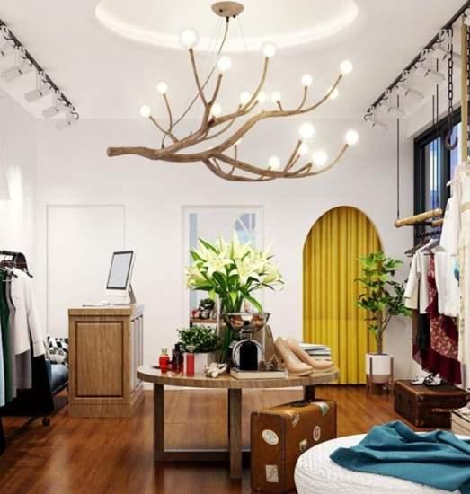 Lampadario realizzato con un ramo: un'idea originale e moderna.